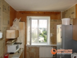 Фото установленного окна на кухне