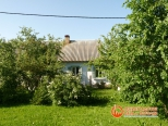 Фото загородного дома после установки окон
