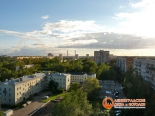 Фото панорамы, сделанное через остекление Slidors